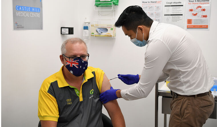 Doctor vaccinating Australian PM against COVID