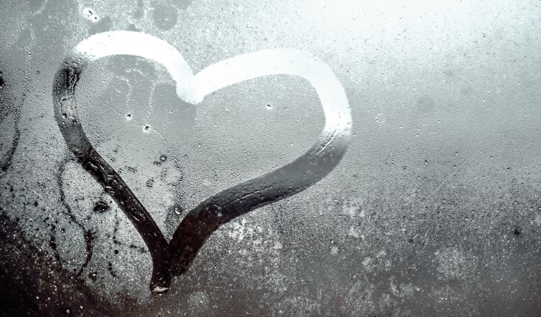 Heart on cold window