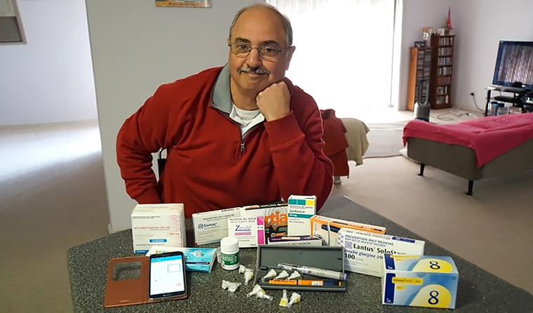 Dom Vitetta says using a smart phone medication-reminder app has helped him with his medication, especially while travelling.