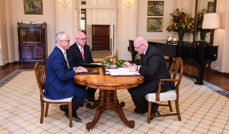 Australian Governor-General Sir Peter Cosgrove (right) signs the Marriage Amendment Act alongside Prime Minister Malcolm Turnbull and Attorney-General George Brandis. Image: AAP/Lukas Coch