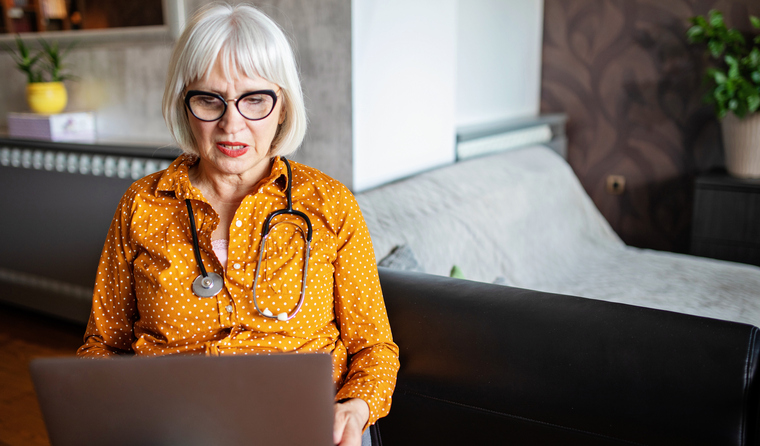 Female doctor watching webinar.
