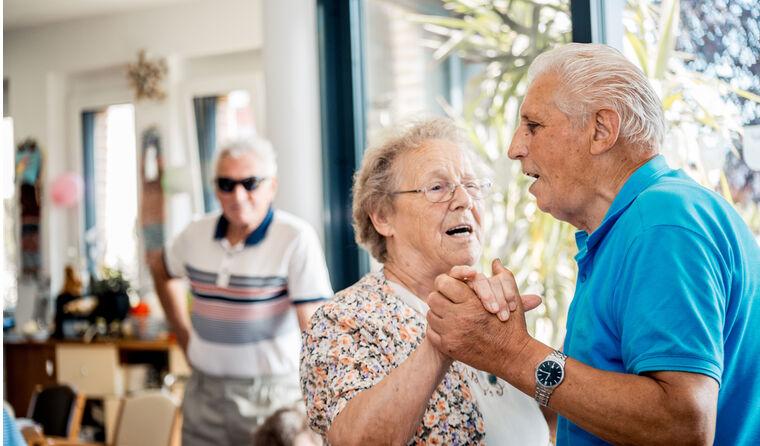 Two older people dancing.