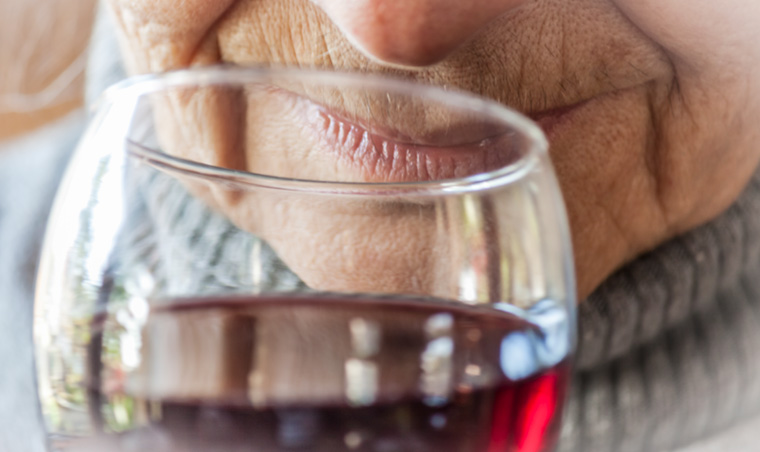 Older person drinking wine