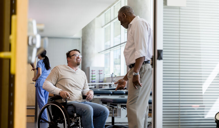 Man in wheelchair talking to doctor