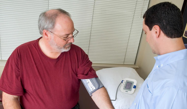 Man having blood pressure checked.