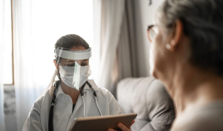 Aged care GP in full PPE