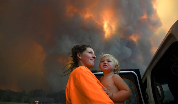 Woman and baby amid bishfire