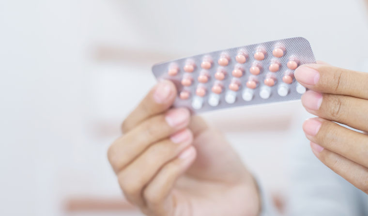 Woman holing the pill