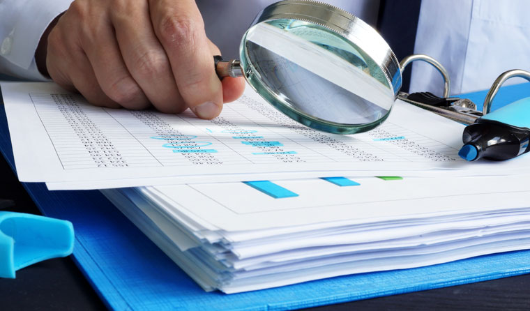 Person closely examining financial documents.