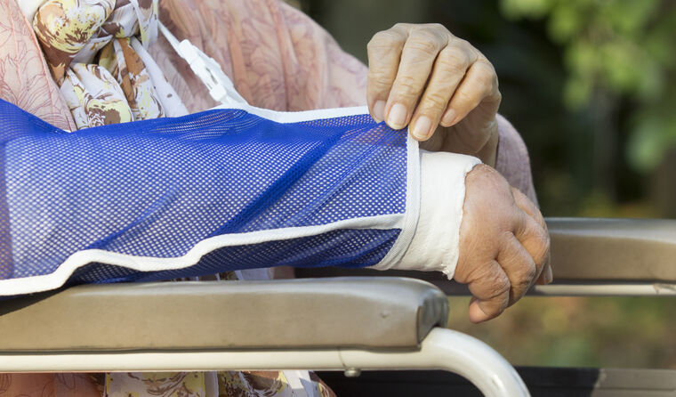 Elderly woman with broken arm