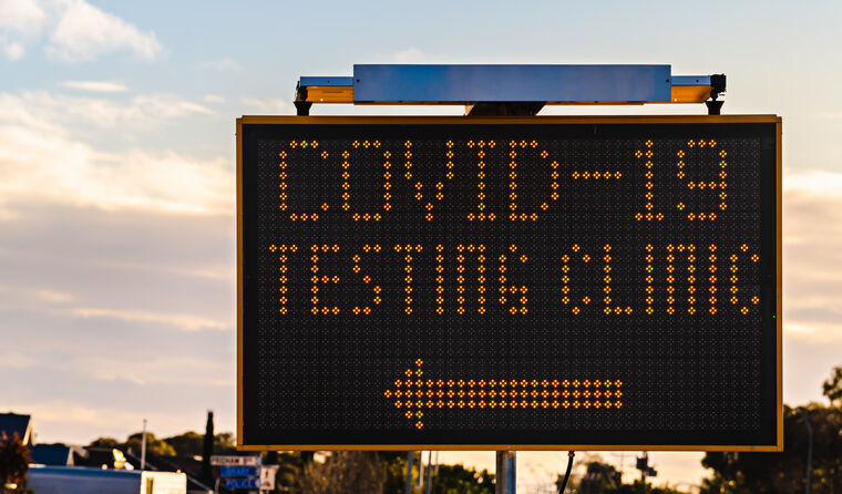 COVID-19 testing clinic sign.