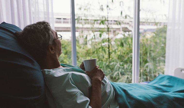 Palliative care patient looking out the window.