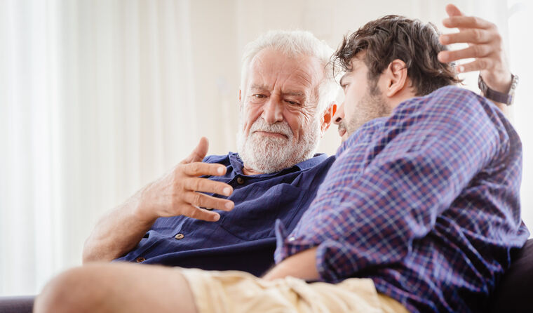 Older man have a heart-to-heart with a relative.