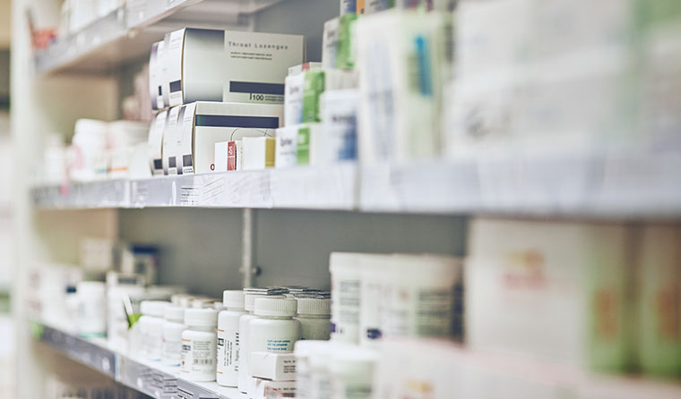 Pharmacy shelf with opioid medication.